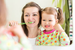 Mother teaching child teeth brushing Royalty Free Stock Photography