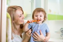 Mother teaching child teeth brushing Royalty Free Stock Photos