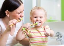 Mother teaching child teeth brushing Stock Image