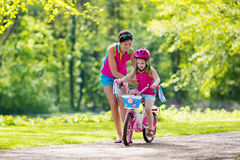 Free Mother Teaching Child To Ride A Bike Stock Photos - 91734433