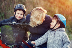 Mother teaching cycling kids outdoor Stock Image