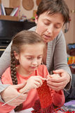 Mother teaching daughter girl knit, emotions and difficulties, handmade and handicraft concept Royalty Free Stock Photography