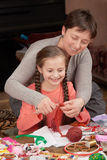 Mother teaching daughter girl knit, job training, handmade and handicraft concept stock photography