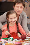 Mother teaching daughter girl knit, job training, handmade and handicraft concept royalty free stock photos