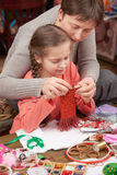 Mother teaching daughter girl knit, job training, handmade and handicraft concept stock image