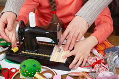 Mother teaching daughter girl sew, job training, handmade and handicraft concept stock photos