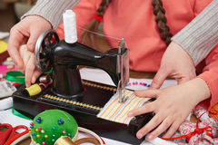 Mother teaching daughter girl sew, job training, handmade and handicraft concept royalty free stock image