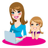 Mother Teaching Daughter. How to use a computer browsing son the internet using a laptop Stock Photo