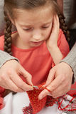 Mother teaching daughter knit, emotions and difficulties, handmade and handicraft concept Stock Images