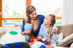 Mother teaching daughter knitting Stock Images