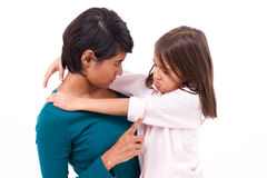 Mother teaching discipline to her daughter. White isolated background stock photo