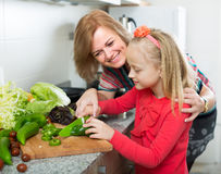 Mother teaching girl to cook Stock Photography