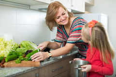 Mother teaching girl to cook Stock Image
