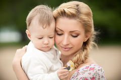 Mother is teaching her baby son. To get to know the world royalty free stock image