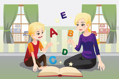 Mother teaching her child. A vector illustration of a mother teaching her child about alphabet letters Stock Photography