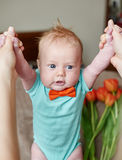 Mother teaching her cute little son to walk holding hands body part first baby steps concept Stock Images