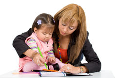 Mother teaching her daughter Royalty Free Stock Photos