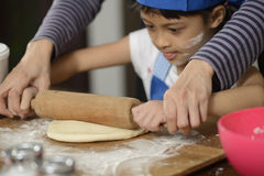 Mother Teaching Her Daughter Making Bread Stock Photography