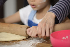 Mother Teaching Her Daughter Making Bread Royalty Free Stock Photo