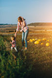Mother teaching her daughter to walk Royalty Free Stock Photo