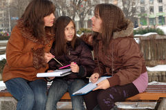 Mother teaching her daughters Royalty Free Stock Images