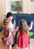 Mother teaching her daughters Stock Photos