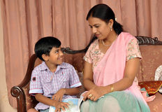 Mother teaching her son Stock Image