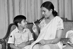 Mother teaching her son Stock Photos
