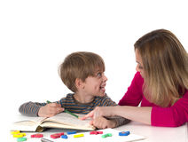 Mother teaching her son Royalty Free Stock Image