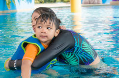 Mother is teaching her son to swim Royalty Free Stock Images