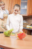 Mother Teaching Her Teenage Daughter How to Cook Royalty Free Stock Photography