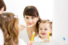 Mother teaching kid teeth brushing Royalty Free Stock Image