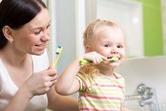 Mother teaching kid teeth brushing Stock Images