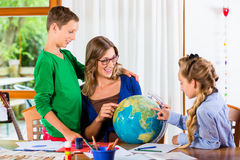 Mother teaching kids private lessons for school Stock Photos