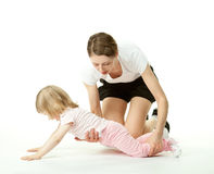 Mother teaching little daughter to do sport Stock Photography