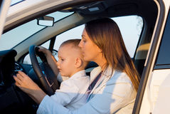 Mother teaching small son to drive Royalty Free Stock Images