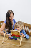 Mother teaching son Stock Photography