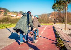 Mother teaching son to ride a bike in cycleway Stock Photography