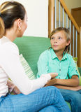 Mother and  teen boy talking in home Stock Photos