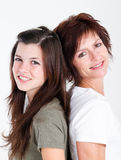 Mother teen daughter. Middle aged mom and teen daughter portrait in studio Stock Image