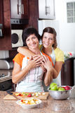 Mother and teen daughter. Happy mother and teen daughter in kitchen Royalty Free Stock Photo