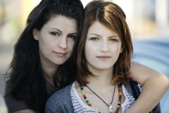 Mother and teen daughter. Portrait of mother and her ten daughter looking at the camera Royalty Free Stock Image