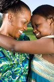 Mother and teen daughter. Young happy african mother and her teen daughter Stock Photos