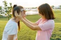 Mother and teen daughter are having fun in nature. Sunny summer day, golden hour, weekend together a parent and teenage child stock images
