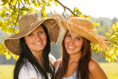 Mother and teen daughter relaxing outdoors happy Royalty Free Stock Image