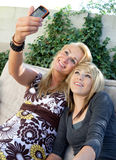 Mother and Teen Daughter Taking Photo Royalty Free Stock Image