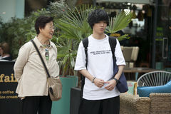 Mother & teen son tourist couple on Spitalfilds market Royalty Free Stock Images