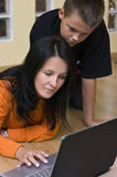 Mother and teenage boy with laptop Stock Image