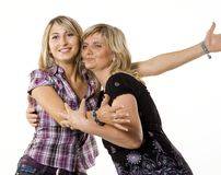 Mother and teenage daughter hugging stock photography