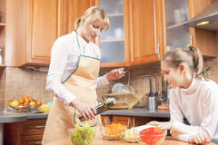 Mother and Teenage Daughter Preparing Vegetables For  Salad Stock Photography
